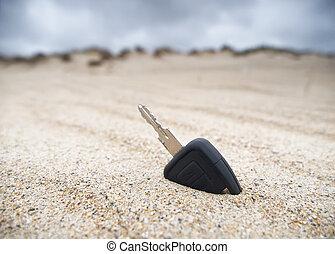 autó kulcs, homok