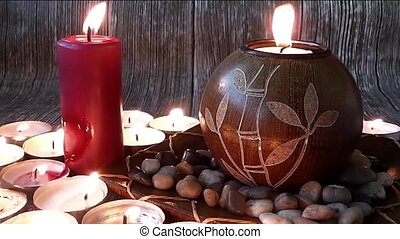 Authentic Atmosphere 2 - candles and Stones on wooden...
