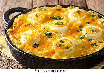 Authentic British food. Anglesey eggs baked with mashed ...