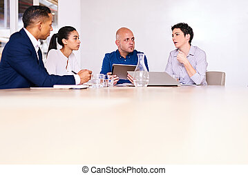 authentic group of business people sitting at a conference table