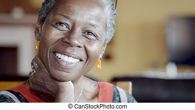 Authentic moment of a senior African American woman smiling and laughing