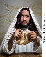 Jesus breaking the bread