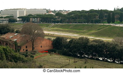 Authenticity of Rome, Italy in ancient and modern buildings and monuments. Core of landscape is Circus Maximus.
