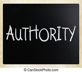 """Authority"" handwritten with white chalk on a blackboard"