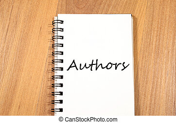 Authors write on notebook