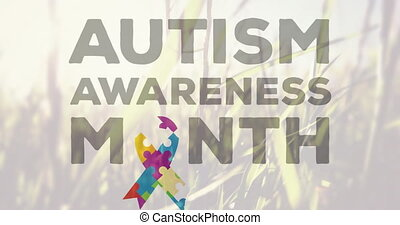 Autism Awareness Month text against tall grass moving in the...