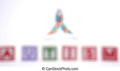 Autism blocks and ribbon on white background