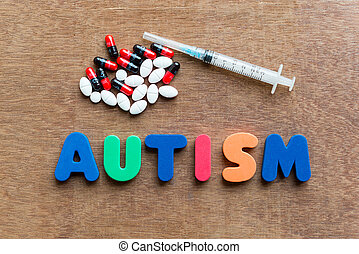 autism colorful word in the wooden background