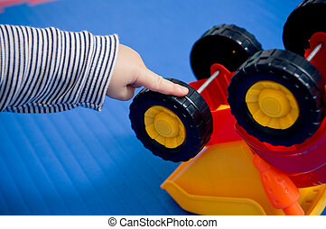 Autistic behaviour? - Toddler's hand turning wheels on...
