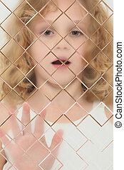 Autistic Child Blurred Behind Pane Of Glass