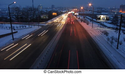 Auto 2 - Wide timelapse shot of cars at night in an urban...