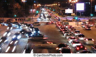 Auto 5 - Wide timelapse shot of cars at night in an urban...