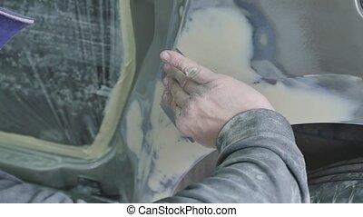 Auto body repair series : Working on putty.