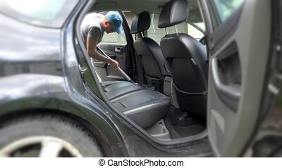 Auto car service cleaning seat, cleaning and vacuuming...