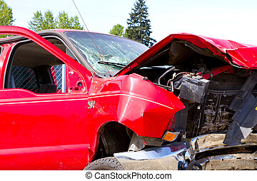 Detail of a vehicle at the auto salvage yard after a major accident collision.