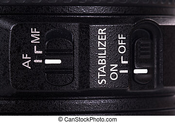 Auto focus and stabilizer modes on or off on camera lens.