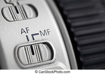 Detail of the auto focus switch on a long photo lenses