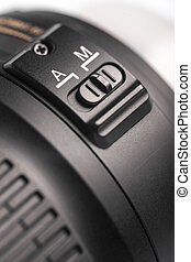 Detail of the auto focus switch on a photo lenses