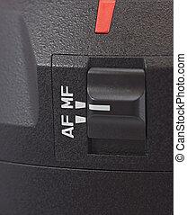Selector manual-auto focuslens reflex