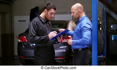 auto mechanic and customer at car shop - auto service,...