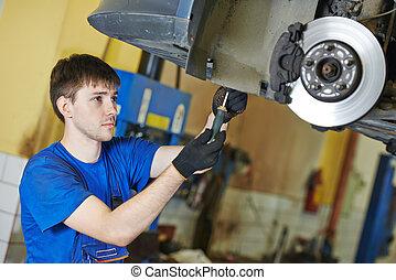 auto mechanic at brake check