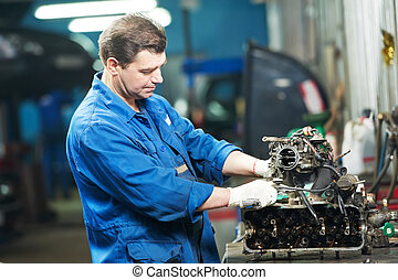 auto mechanic at repair work with engine - automotive ...