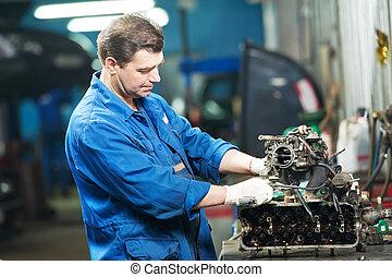 auto mechanic at repair work with engine