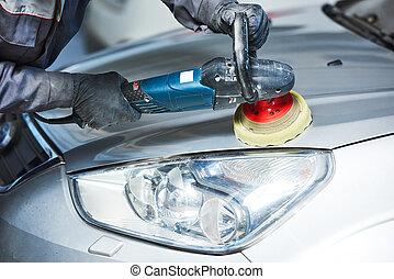 auto mechanic buffing car autobody bonnet