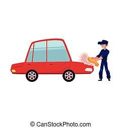 Auto mechanic cleaning, washing, polishing a car
