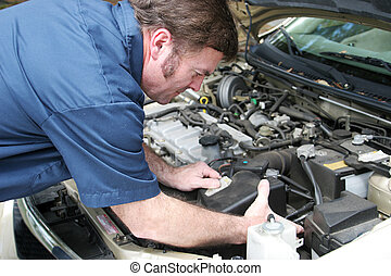 Auto Mechanic - Engine Work - Auto mechanic under the hood,...