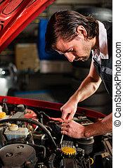 Auto mechanic fixing car engine