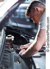 Auto mechanic fixing car