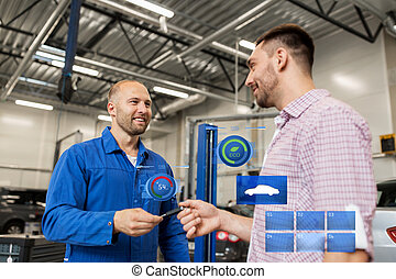 auto mechanic giving key to man at car shop - auto service,...