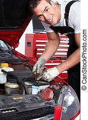 Auto mechanic - Handsome mechanic working in auto repair...