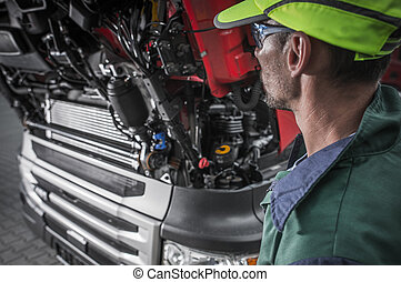 Auto Mechanic Looking Under Hood Of Car.