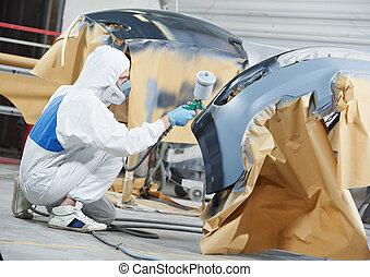 auto mechanic painting car bumper - auto mechanic worker...