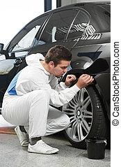 auto mechanic painting car element - auto mechanic worker ...