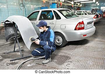 auto mechanic polishing car - auto mechanic worker polishing...