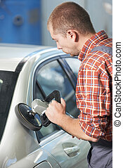 auto mechanic polishing car body
