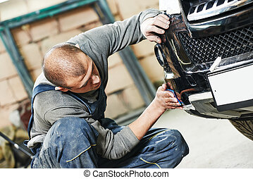 auto mechanic polishing car - auto mechanic worker sanding...