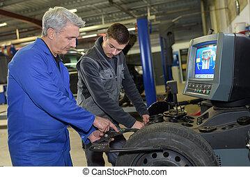 auto mechanic professor shows the trainee maintenance