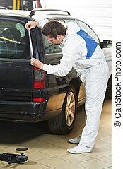 auto mechanic protecting car before polishing - auto ...