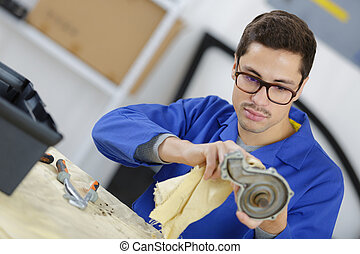 auto mechanic repairing car part