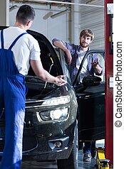 Auto mechanic servicing a car