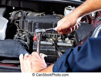 Auto mechanic - Hands of mechanic working in auto repair...
