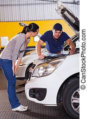 auto mechanic talking to customer - auto mechanic talking to...