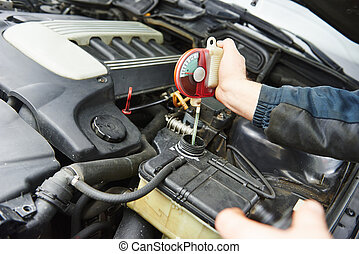 auto mechanic tests car antifreeze liquid - automobile...