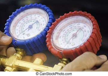 Auto mechanic uses a pressure gauge on the air compressor,liquid air pressure,compressor,manometer in a car.