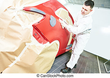 auto mechanic wiping car