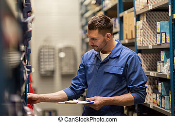 auto mechanic with clipboard at car workshop - car service,...
